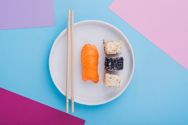 Flat lay plate with sushi rolls