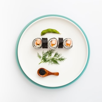 Flat lay plate with sushi