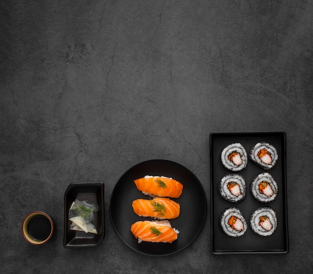 Flat lay plates with maki and nigiri sushi with copy space