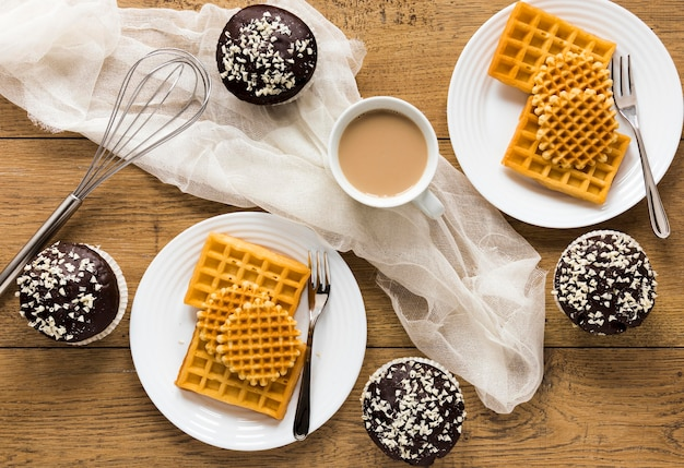 Flat lay of plates with waffles and coffee