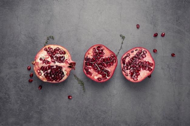 Flat lay of pomegranate fruit halfs
