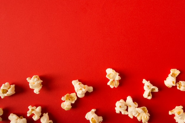 Flat lay popcorn assortment on red background with copy space