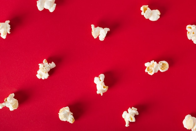 Flat lay popcorn on red background