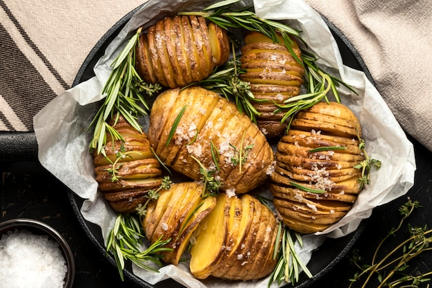 Flat lay of potatoes in pan with rosemary
