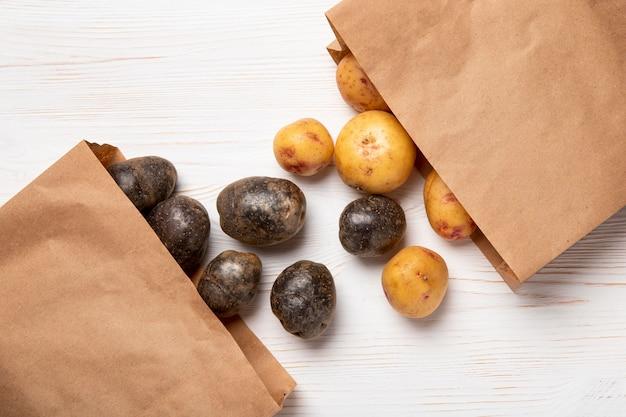 Flat lay potatoes in paper bags