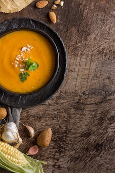 Flat lay pumpkin cream soup in bowl