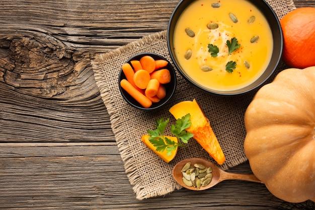 Flat lay pumpkin soup with carrots and pumpkin