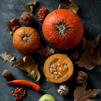 Flat lay pumpkins and autumn leaves