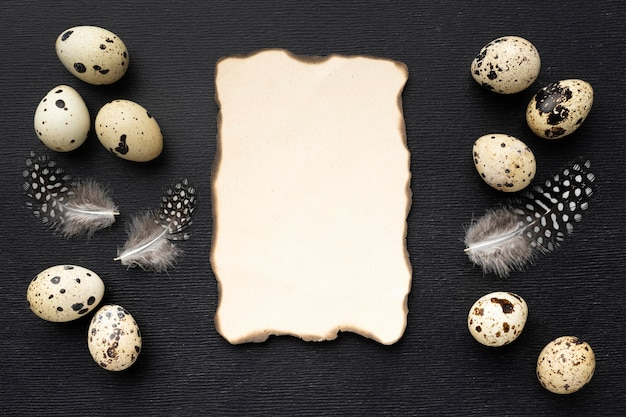 Flat lay quail eggs with paper piece