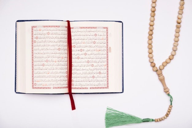 Flat lay quran opened on table