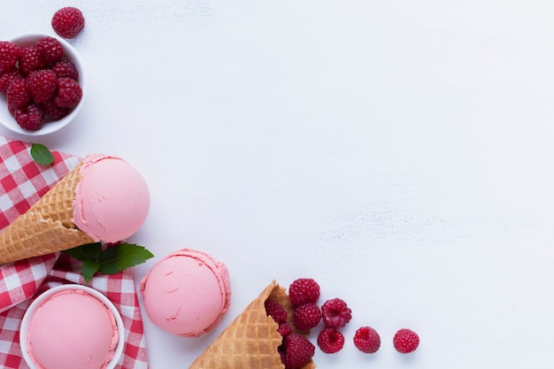 Flat lay of raspberries ice cream with copy space