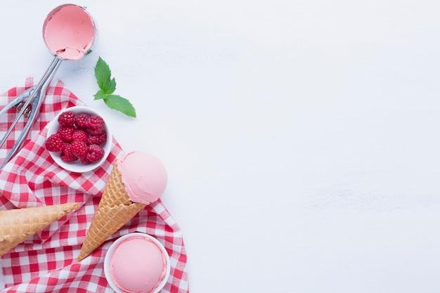 Flat lay of raspberries ice cream