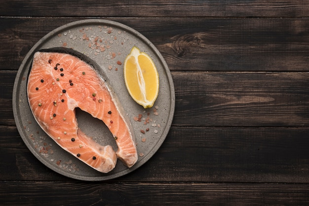 Flat lay raw salmon steak on tray with copy space