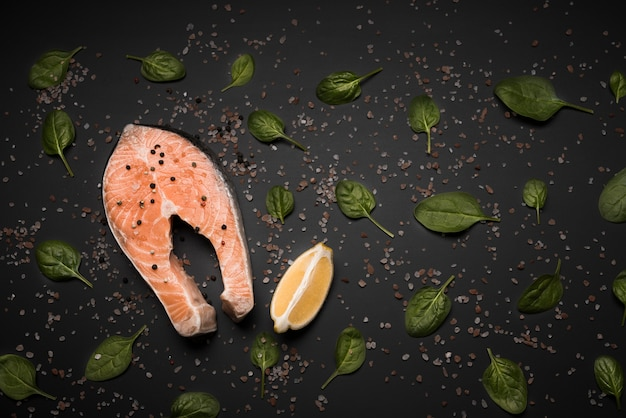 Flat lay raw salmon steak with basil