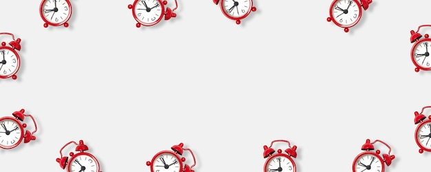 Flat lay red alarm clock on white