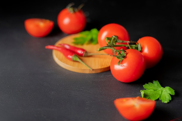 Flat lay red fresh organic natural cherry tomatoes on the table, vegan salad ingredients