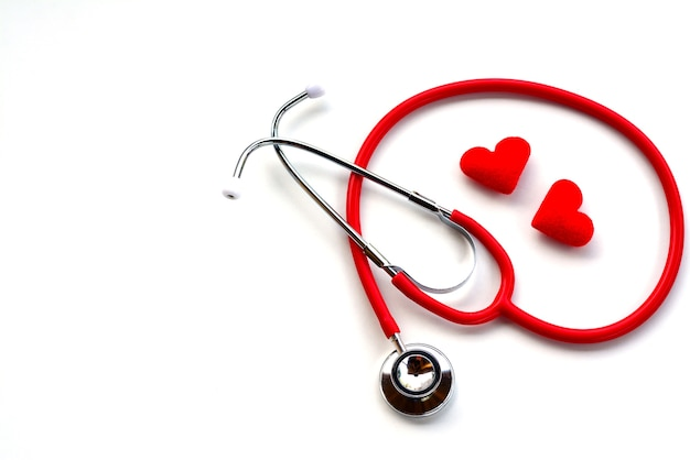 Flat lay of red medical stethoscope and red hearts on white background using for healthcar