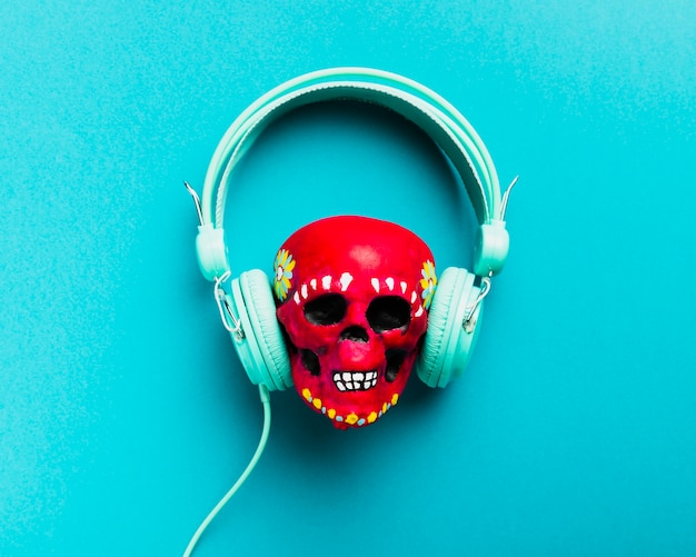 Flat lay red skull with headphones