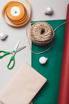 Flat lay of ribbon and string for christmas Free Photo