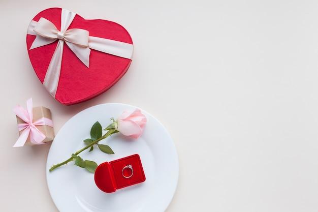 Flat lay romantic arrangement on white background