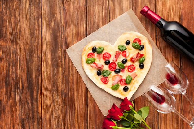 Flat lay romantic dinner table with pizza