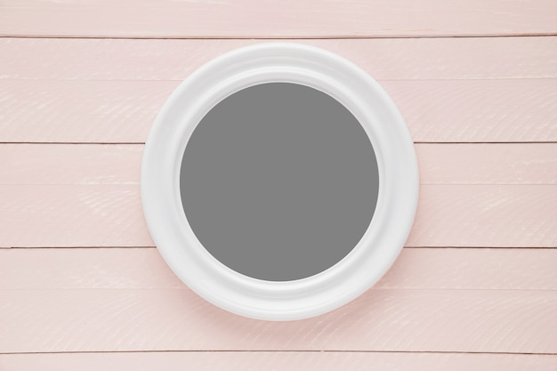 Flat lay round frame on wooden background