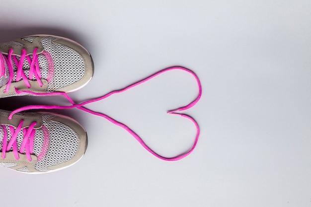 Flat lay running shoes with heart shaped laces