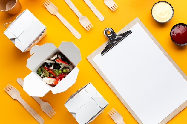 Flat lay salad box with clipboard mock-up