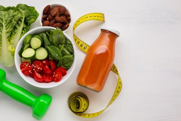 Flat lay of salad and natural juice
