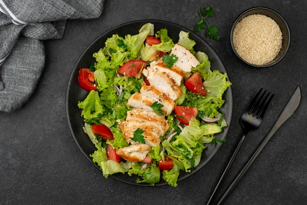 Flat lay salad with chicken and sesame seeds