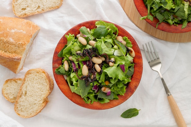 Flat lay salad with white beans and bread