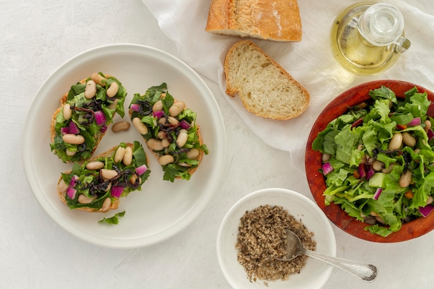 Flat lay salad with white beans on bread