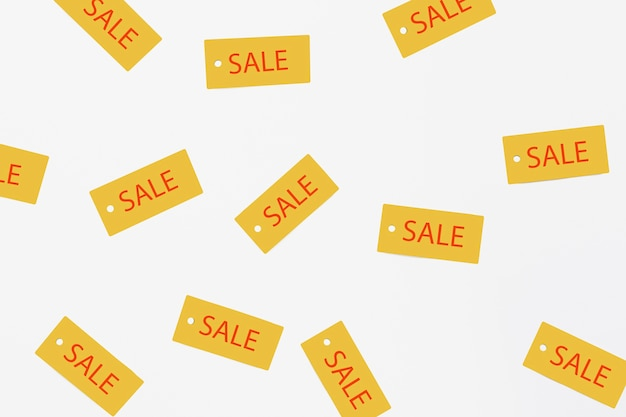Flat lay of sale tags on plain background