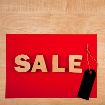 Flat lay of sale word on wooden table