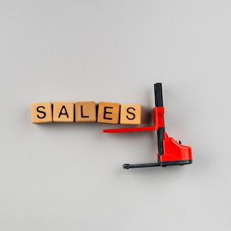 Flat lay of sales letters with forklift on plain background