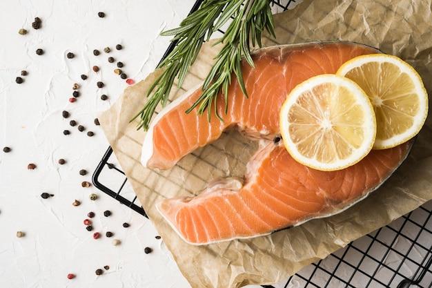 Flat lay salmon with herbs and lemon
