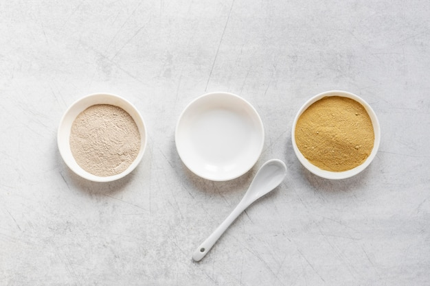 Flat lay sand in bowls and spoon