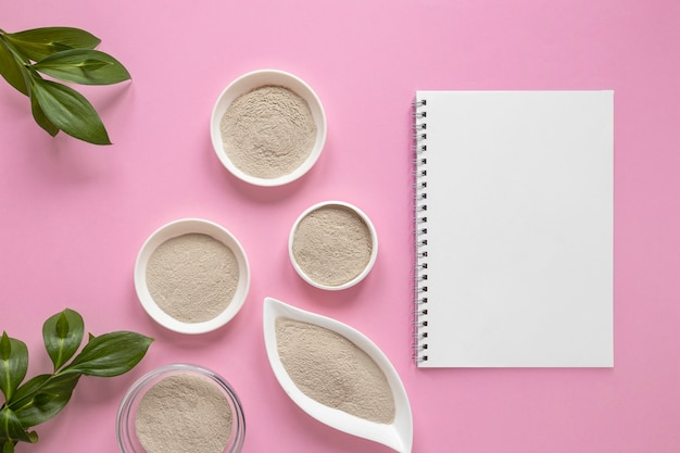 Flat lay sand and copy space notepad