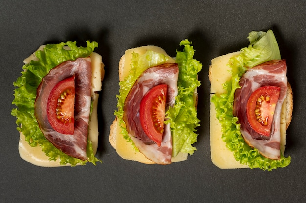Flat lay sandwich arrangement on plain background