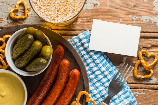 Flat lay of sausages with beer and sausages