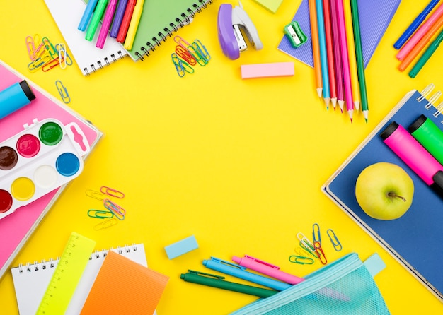 Flat lay of school essentials with colorful pencils