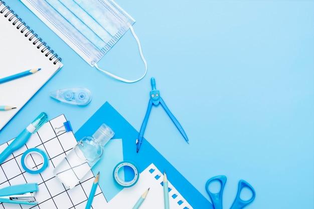 Flat lay school items on blue background