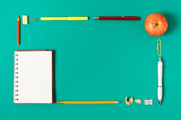 Flat lay school supplies frame