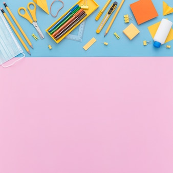 Flat lay of school supplies with copy space