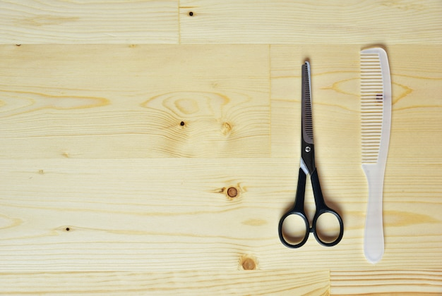 Flat lay of scissors and comb