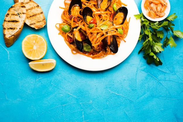 Flat-lay seafood dishes with copyspace