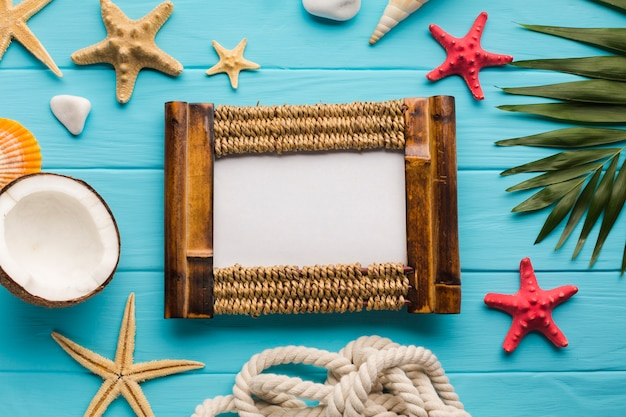 Flat lay seaside composition with picture frame