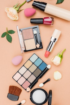 Flat lay set of beauty products on beige background