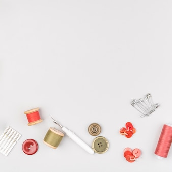 Flat lay of sewing supplies with copy space