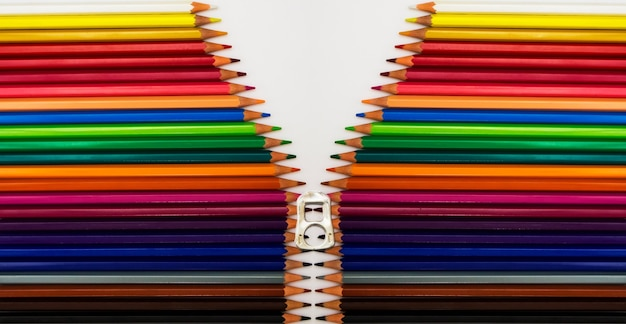Flat lay shot of colorful pencils on a white surface